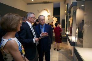 Dr Henryk Meyza, director of the PCMA mission in Nea Paphos, showing guests around the exhibition